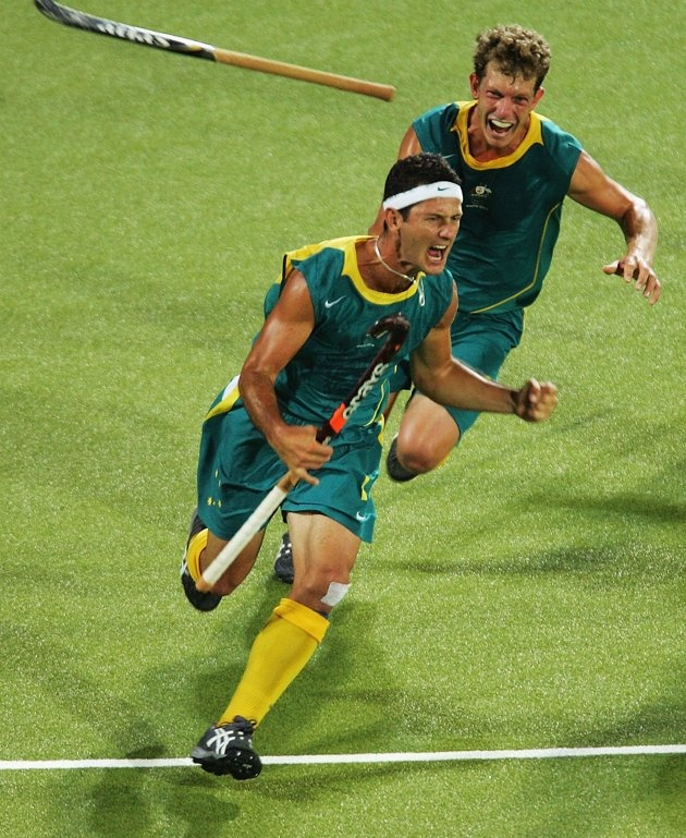 Inspirational Moments: Olympic celebrations - ATHENS - AUGUST 27: Jamie Dwyer #1 of Australia celebrates after scoring the winning goal in men's field hockey gold medal match against the Netherlands on August 27, 2004 during the Athens 2004 Summer Olympic Games at the Helliniko Olympic Complex Hockey Centre in Athens, Greece. (Photo by Stuart Franklin/Getty Images)