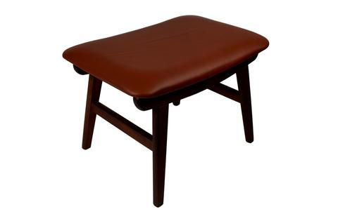 A teak ottoman upholstered with brown aniline leather