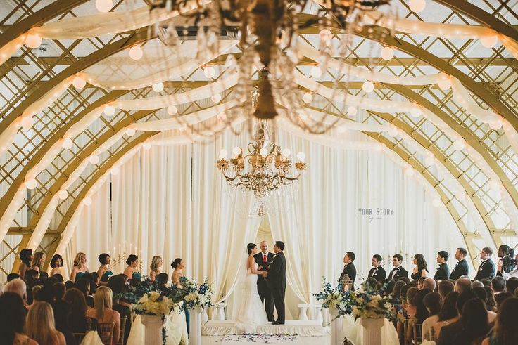 The Kapok Tree Inn is a wondrous venue for any wedding! | The Florida Room Chapel is a romantic and serene space, canopy chandeliers throughout and domed lighting are sure to make any wedding feel private and special!