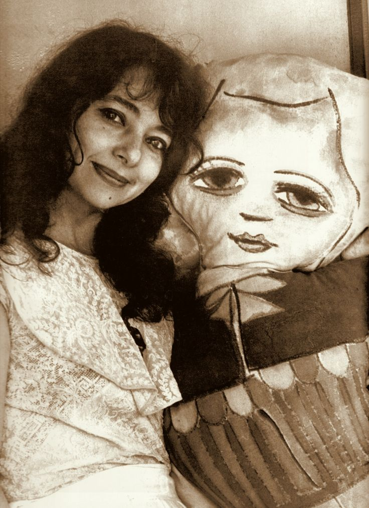 MIRKA MORA & one of her hand painted dolls. Mirka & her husband Georges Mora had arrived in Melbourne in 1951 and at their own studio at 9 Collins Street, created an even livelier art scene. Image from 'Collins the Story of Australia's Premiere Street' by Judith Raphael Buchrich 2005. (minkshmink on pinterest)