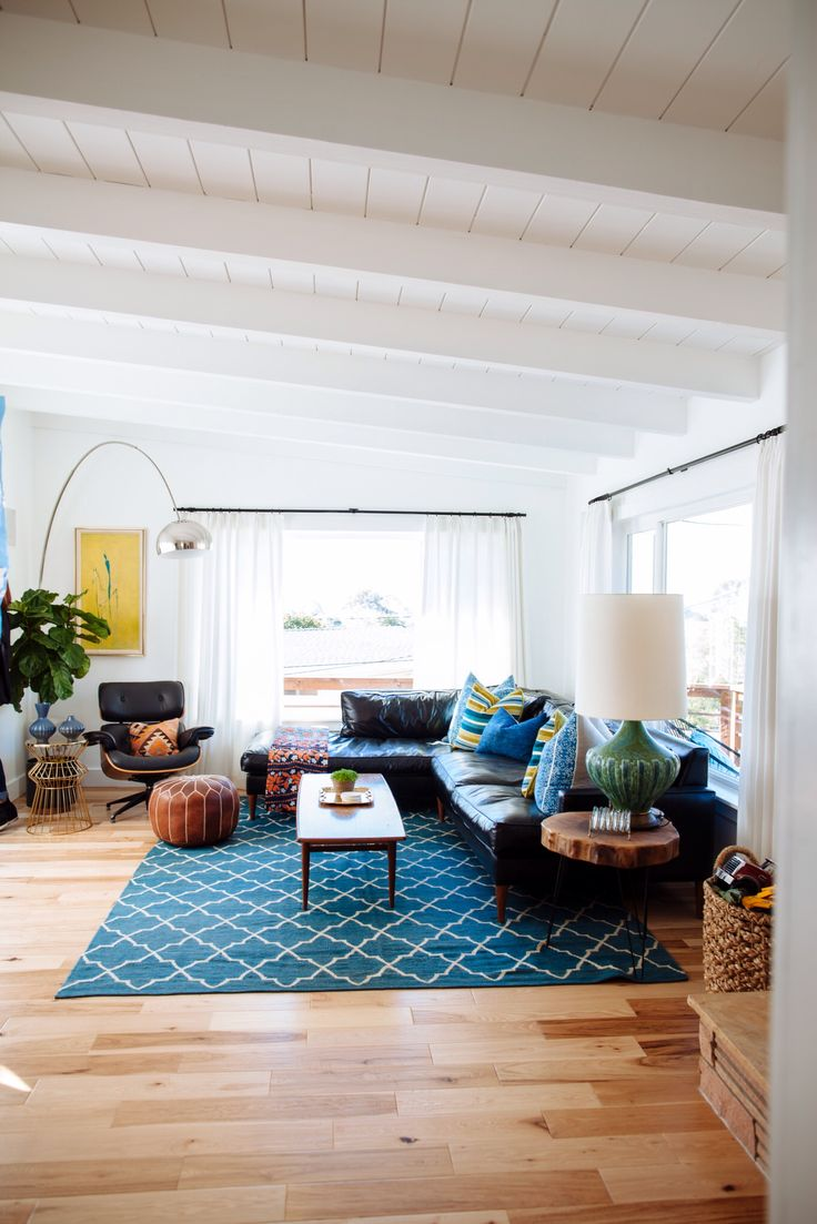 So very similar to my living room (though I envy that lovely white/wood ceiling and the second window!)