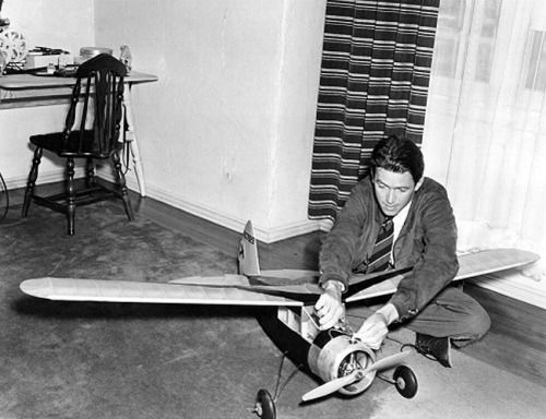 joelmccrea:   lars134:   Jimmy Stewart at home working on one of his model airplanes, 1938  inessentialhouses