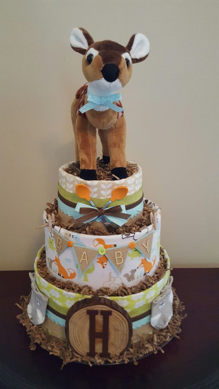 Woodland themed baby boy diaper cake.  Baby shower centerpiece, precious and practical baby gift. Check out my Facebook page Simply Showers for more pics and orders.  https://m.facebook.com/adorablegifts