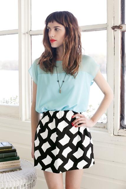 mint top + graphic print skirt.