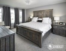 Master suite. Large casement windows, chandelier. Opal in Keswick, by Kimberley Homes.