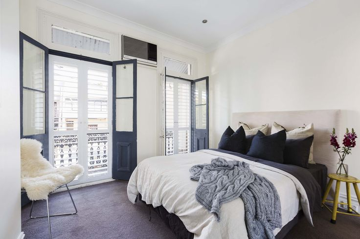 Cosy master bedroom with gorgeous French doors at 474 Bourke Street, Surry Hills