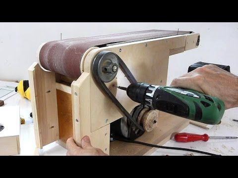 "Making the stand, wooden pulley, and adding dust collection to the homemade 6x48"" belt sander http://woodgears.ca/belt_sander/build2.html This is a continuat..."