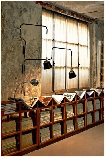 industrial piping lamps. record storage. magazines, newspapers, books, maps.