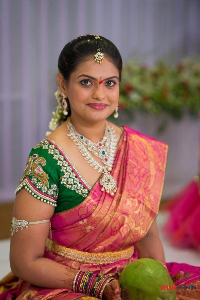 South Indian bride. Temple jewelry.Pink silk kanchipuram sari with contrast green blouse. Braid with fresh flowers.Tamil bride. Telugu bride. Kannada bride. Hindu bride. Malayalee bride.