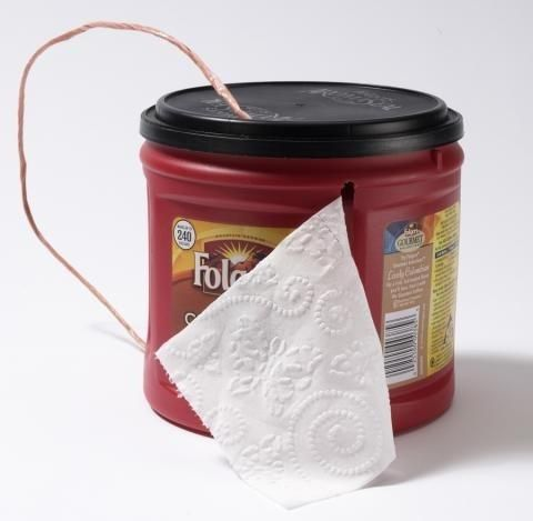 Reuse a Folgers can to store and carry toilet paper.