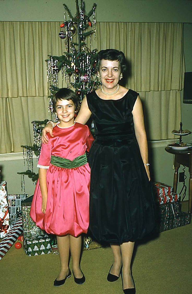 Mom and me in our balloon dresses she made, Christmas 1959