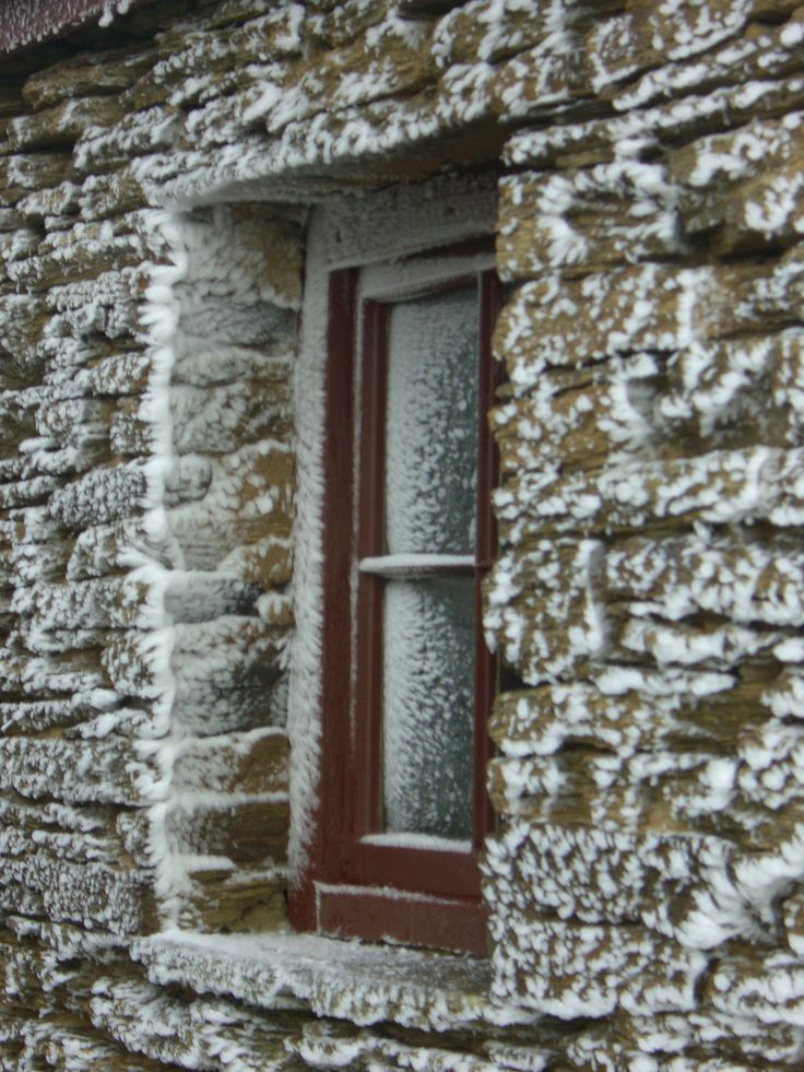 Mitchell's Cottage, Fruitlands, Central Otago. Snow flakes cling to the stone work... http://www.centralotagonz.com/mitchells-cottage
