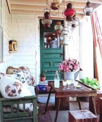 I love these lanterns hanging on the porch ceiling. I also love that door and the whole feel of this porch!