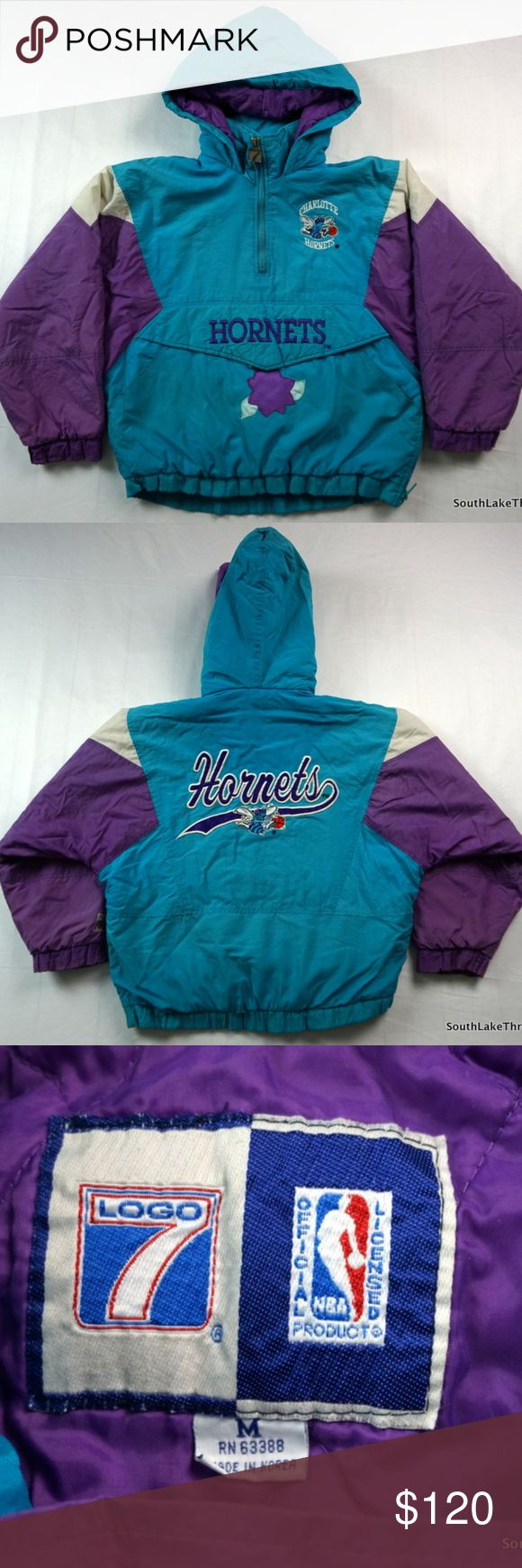 """VTG 90s Charlotte Hornets Winter Pullover Jacket Vintage 90s Charlotte Hornets Winter Pullover Jacket, Coat, Youth Boys Medium, NBA Basketball, Teal/Purple/White Hood, Logo 7, 90s Fashion  Brand:      Logo 7 Official NBA Color:       Teal/Purple/White Material:  Shell 100% Nylon, Lining 100% Nylon, filling 100% Polyester  Detailed Measurements: (Front Side of Garment has been measured laying flat on a table)  Sleeves:    25"""" inches  Chest:       21"""" inches Length:     22"""" inches Logo 7…"""