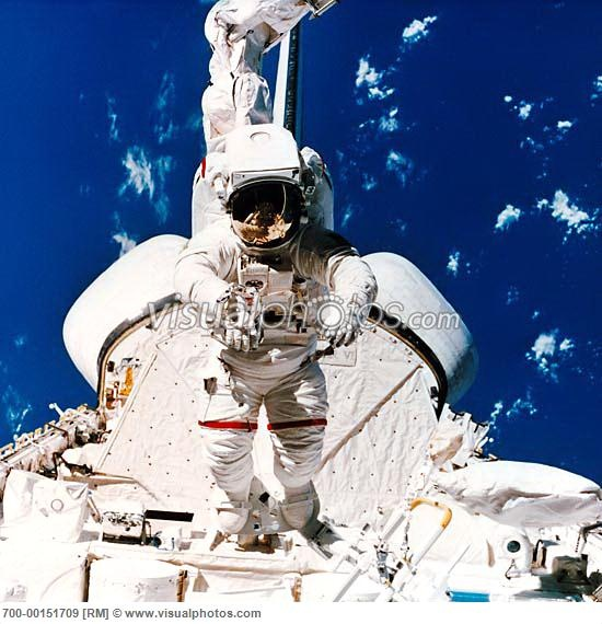 Astronaut on Space Shuttle with Canada Arm