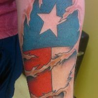 Texas Flag under skin shreds... good coloring.  Tattoos by Matt at Virtue Tattoo