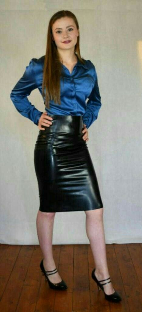 6801f35d26 Young girl in shiny black leather skirt blue satin blouse and Mary Janes