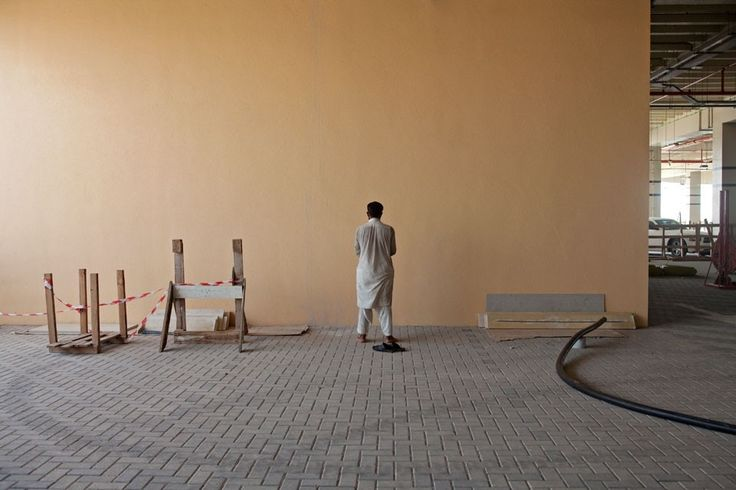 Observance: a study of prayer by Jeff Topping | The National  Read more: http://www.thenational.ae/blogs/national-view/observance-by-jeff-topping#2#ixzz38pWXdIty  Follow us: @TheNationalUAE on Twitter | thenational.ae on Facebook. A labourer offers Asr prayers at a construction site in Ras al Khaimah City.