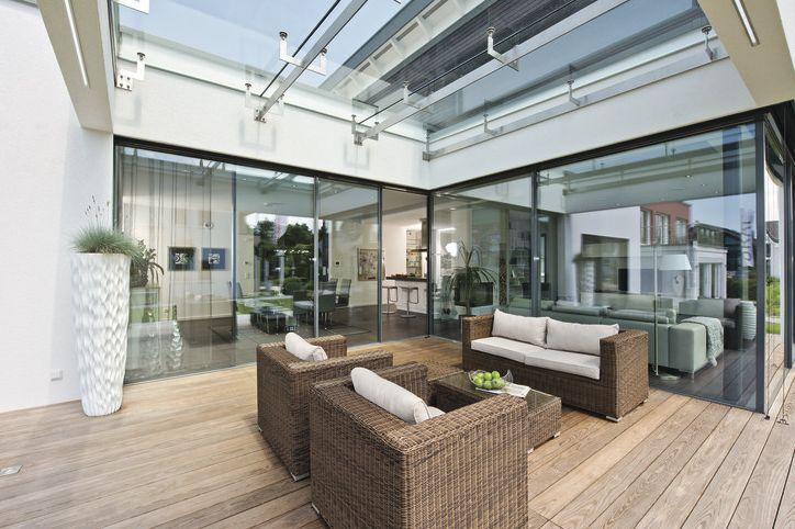 #bungalow #groundlevel #ebenerdig  Living area is widened onto the Patio thanks to the doors and large glass planes.  Sie vergrößern den Wohnraum auf die Terrasse durch die großzügigen Glasflächen, den ebenerdigen Ausgang und das Grundrisskonzept.