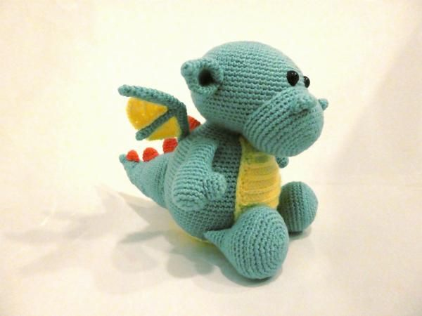 Vote for Martin the baby dragon by Lili & Stitch - http://www.amigurumipatterns.net/designcontest/vote/?id=1273 - Martin is a newborn baby dragon. He is shy at first, but once you gain his trust he likes to come over and cuddle up.  His biggest dream is to be able to fly. Until his wings are strong enough, he uses his balloon to float around the room. A proof that creativity can go a long way in making your dreams come true!