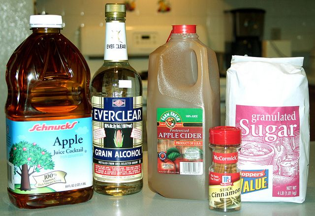 Apple Pie Shots ~ 1 Gallon apple juice, 1 Gallon apple cider, 7 Cinnamon sticks, 4 Cups of sugar, 1 Liter of Everclear