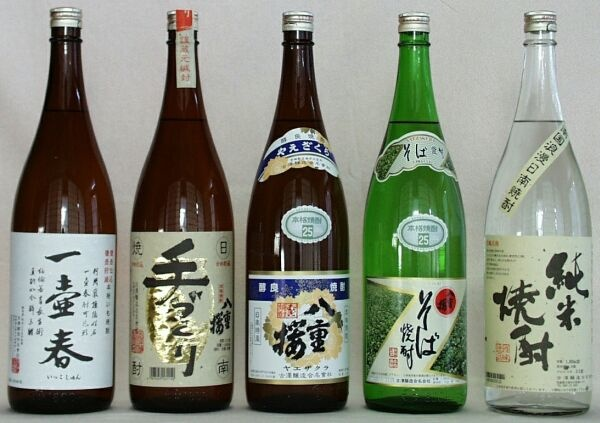 焼酎 - shouchu  Japanese vodka   Made from buckwheat, rice, potato, all different materials.  Unlike Japanese sake, these shouchu liquors don't give you much hangover!