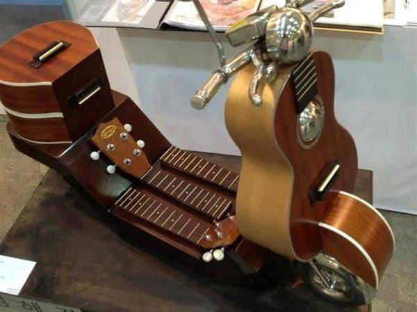 Not an instrument strictly .. as far as I can see .. but a beautiful way to upcycle old instruments into working ornaments .. I'd ride this any day :)