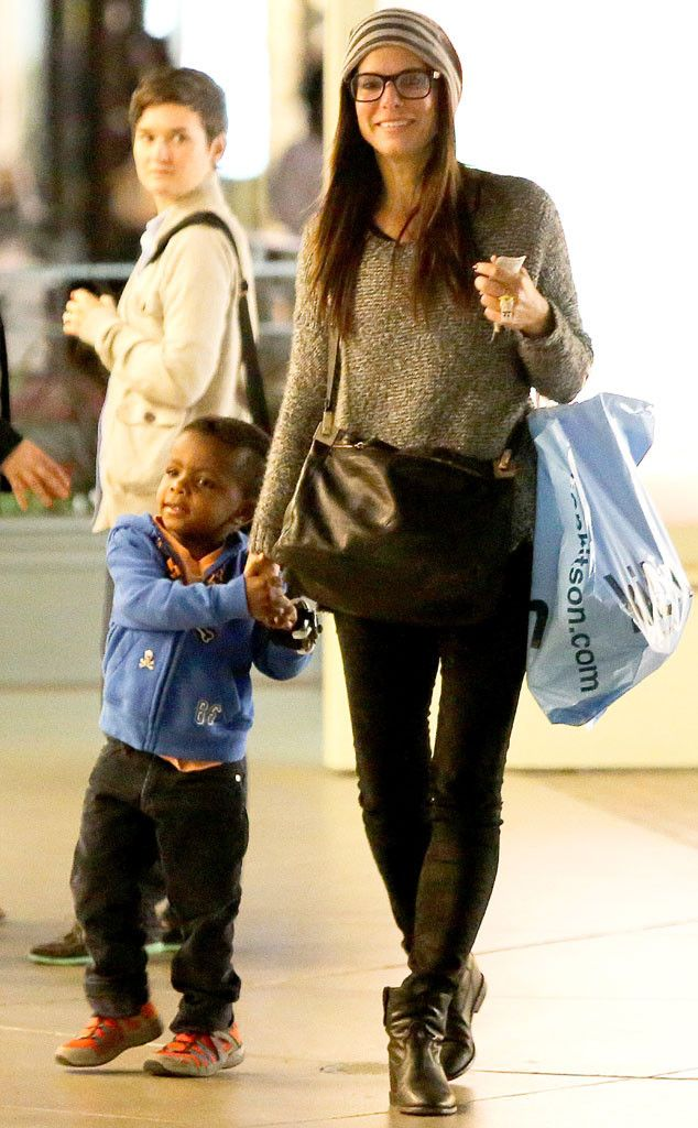 Momma Sandra Bullock took a trip to the movies with her smiley son Louis! Good thing she sported her specs! Gotta be able to see the screen clearly, y'all!