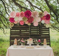 Paper flower backdrop, flower wall for and outdoor or rustic wedding. Love these oversized flowers by PaperFlora. Photo by Janeane Marie Photography