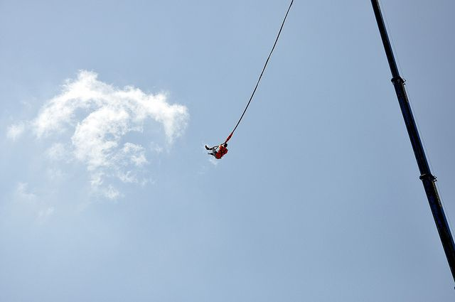 4. Bungee Jumping:  Jumping from a tall structure while connected to a large elastic cord. It is an amazing free falling experience, especially when done off a cliff or at the beach.