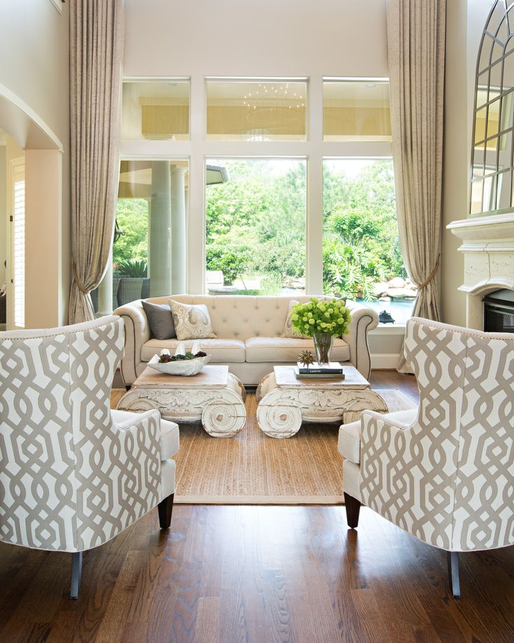 Living Room   Amanda Carol Interiors White Base Colors Can Consolidate  Different Styles Of Furniture  Love Those Chairs And Coffee Tables.