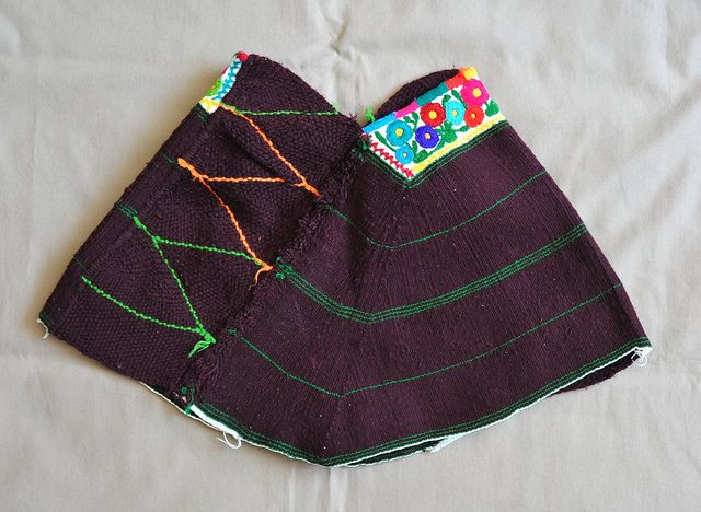 """This is a quechquemitl from Santa Ana Hueytlalpan Hidalgo, an Otomi(indigenous) community near Tulancingo. This miniature quechquemitl is not worn as a cape, but the sides are folded inward and these are worn as caps by Otomi women of the town. The point at the botton edge of the quechquemitl was created using the technique of curved weaving."" http://www.flickr.com/photos/citlali/5568240254/in/set-72157594380028165"
