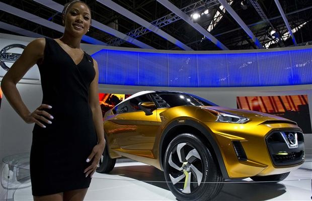 A hostess poses next to Nissan Extrem concept car at the 27th Brazilian International Automobile Fair in Sao Paulo, Brazil.