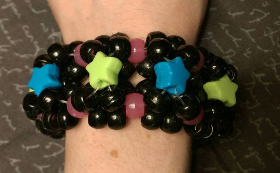 Check out this item in my Etsy shop https://www.etsy.com/listing/258248240/3d-kandi-cuff-blackmulticolored-glow-in
