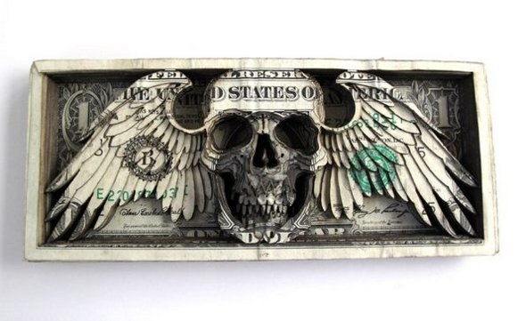 Tattoo artist Scott Campbell is a man of many, varied talents: recently he has been laser cutting tall stacks of dollar bills into delicate three dimensional carvings. His piles of currency feature many of the traditional tattoo symbols we are accustom to: skulls, religious art, guns, roses. Only adding to the raw nature of his work: it's technically illegal to destroy or deface currency.