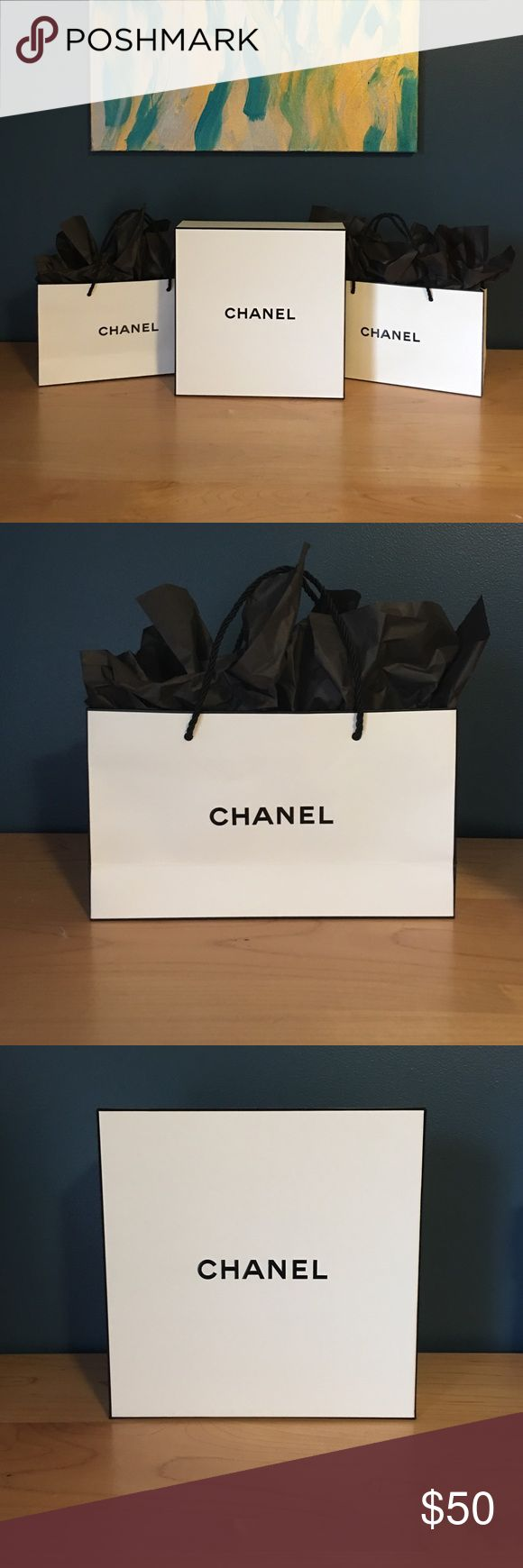 CHANEL Bags + Boxes Two small CHANEL shopping bags with black tissue paper and one medium CHANEL box. CHANEL Bags