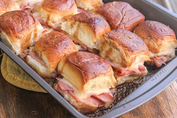 Funeral Sandwiches: Oh how my mouth waters when I think about these ham and cheese sliders! It's all about the sauce!!!