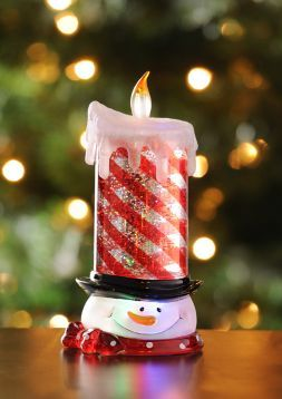 The LED Glitter Snowman Candle is filled with sparkles and glows! #kirklands #holidaydecor #KirklandsHoliday