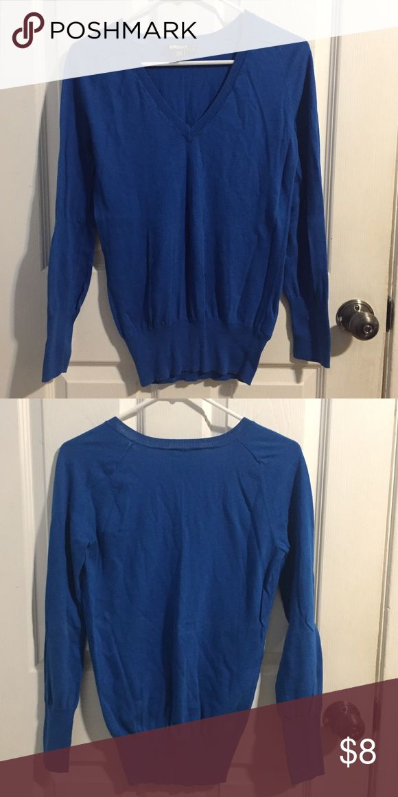 Royal blue oversized sweater Royal blue oversized sweater. Can be worn as a sweater dress if you're a size XS! Otherwise it's best looking worn with leggings! Can fit XS-M DKNY Sweaters V-Necks