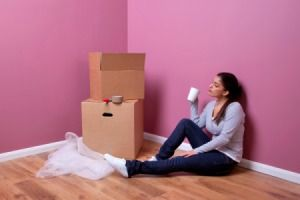 Young woman sitting next to moving boxes.Apartments Gift Baskets, Moving Company, First Apartments Gift, Full Service, Life Biggest, Finance Service, Baskets Ideas, House Warming Gifts, Service Moving