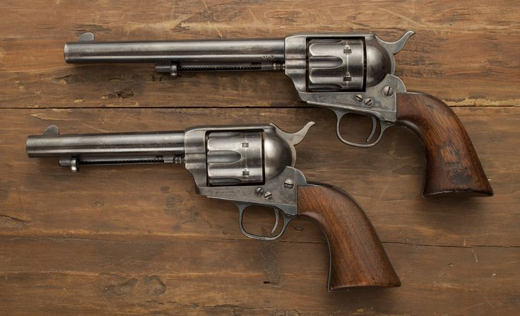 "Colt Single Action Army Revolvers -Our GOTDs are a martially-marked 7 ½ inch Colt and a martially-marked 5 ½ inch ""Artillery"" Colt, both chambered in .45. The basic single-action Colt .45 was issued to the US military from 1873 and mustered on through the Indian Wars and the Spanish-American War. If you are a fan of General Patton – you could say it was still in service during WWII. NRA Museum at Bass Pro Shops in Springfield, MO"