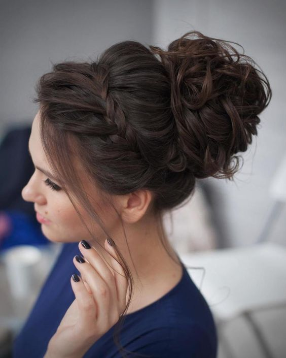 Curly Messy Bun Prom Updo. Image saved for hair inspiration for use in projects by Adagio Images, http://www.adagio-images.com, http://www.facebook.com/adagioimages. #hair #hairinspiration #updo