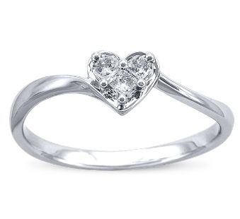 Three diamond heart promise ring. His birthstone, mine, the month we met/dated