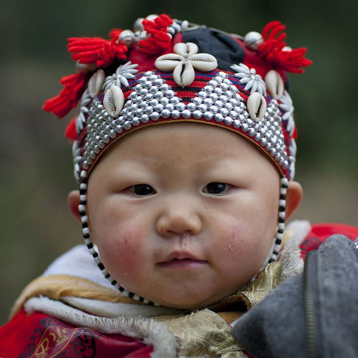 Vietnam | Red Dzao Baby With A Traditional Hat.  Sapa | Red Dzao are a subgroup of the Dao, one of the 54 ethnic minorities in Vietnam. There are about 470,000 of them living in northern Vietnam, close to the chinese border (a lot can also be found in China and Laos). They originally migrated from China during the 19th century. Hence Dao have long used Chinese writings (but pronounced in the Dao way) called Nom Dao. | © Eric Lafforgue