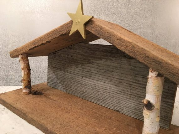 Handmade, one of a kind manger for your heirloom nativity figurines. (The figures shown in one of the photos are not included) This nativity stable was made by me with barn wood and birch branches from my own property. There is not another one like it. Sure to be an instant heirloom, complete your Christmas decor with this nativity stable.  The Joseph figurine in the photo stands 3.25 tall, but this stable would accommodate figurines up to 5 tall. Dimensions: 20 wide x 8 deep x 11 to the top…