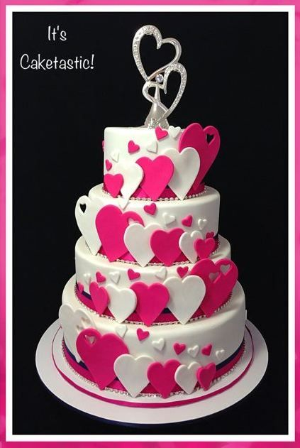 Other / Mixed Shaped Wedding Cakes - A cascade of hearts for a very romantic wedding!  The four tiers were cherry ripe mud cake, mars bar mud cake, jaffa mud cake and white chocolate and raspberry mud cake.  The hearts were made from fondant.  The white hearts and the entire cake were airbrushed with pearl shimmer.  The wedding colours were pink and navy so I used double ribbon to trim each tier and added diamanté trim to give it extra sparkle (see the other photos for close ups).  The…