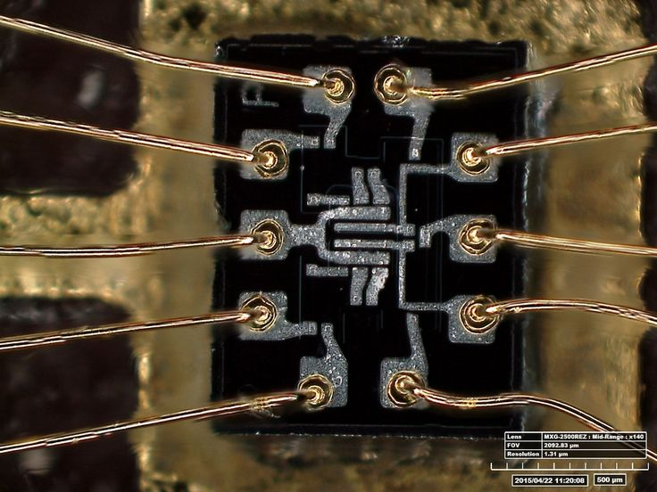 Microscopic view of the 3-element NOR gate used for the Apollo Guidance Computer—an early, high-profile application of the then-new silicon integrated circuit.