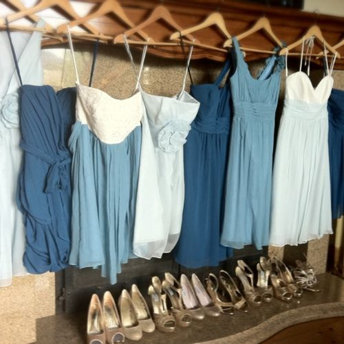 I like the mismatched dresses in different shades of blue, throw in some pink (my colors) and it would be so cute!