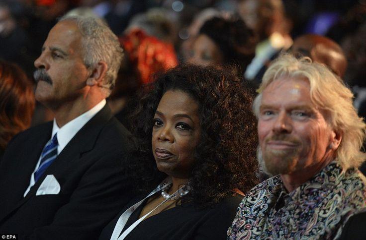 Mourners: US talk show host Oprah Winfrey, centre, her husband Stedman Graham, left, and English businessman Richard Branson, right, watchin...