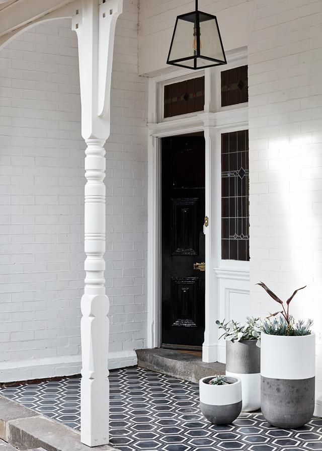 Statement tiles in a hexagonal shape enliven this monochromatic verandah. Photography: Sean Fennessy | Styling: Heather Nette King